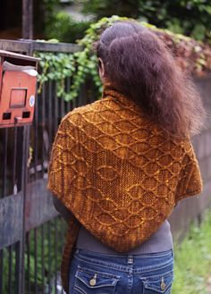Description of pattern: Apis Dorsata Laboriosa (a.k.a. the Himalayan honey bee) dwells in the mountains of Bhutan, Nepal, China, and India. These giant bees build large yellow and golden honeycombs that hang down from the cliffs. This scarf is inspired by the workmanship of the bees.