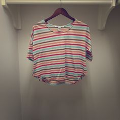 American Rag Striped Crop Adorable oversized cropped tee from American Rag. Never worn. Cream color with blue, brown, peach and pink stripes. Size small fits XS-Med. American Rag Tops Crop Tops
