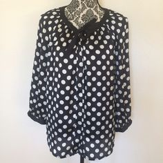 """Adorable polka dot blouse Silky and flowy polka dot blouse. Great to add some cute flair to your everyday office wear. Pair it with jeans fora casual look, or a pencil skirt to dress it up for the office. Has buttons down the front, hidden by an extra layer of pleated fabric.  40"""" bust, 25"""" length in front, 28"""" in back Button Front Closure Solid Black tie at neck  3/4 length sleeves 100% polyester Machine Washable Pre-loved, but in great condition. (No known snags or flaws) Chaus Tops…"""