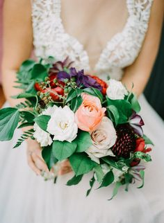 Romantic, jewel tone bridal bouquet of garden roses and clematis by Compass Floral | Fallbrook Treehouse, Fallbrook