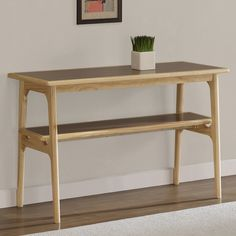 This beautiful, mid-century sofa table with shelf highlights a sturdy solid wood construction that is sure to compliment your home's decor. Smooth lines and a walnut veneer complete the look Finish: Natural finish Dimensions: 30 inches high x 48 inches wide x 20 inches deep