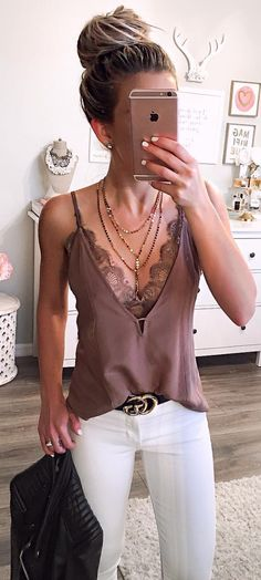 Bralette top, layered necklaces and white pants love!