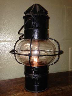 Maritime lantern with blown globe glass.