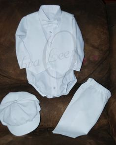 The Christopher Blessing outfit was designed and handmade by Debra Lee Originals. The Christopher Christening / Blessing outfit is made of cotton/poly. This Christening set includes a Dress shirt (bodysuit) that snaps at the crotch, long or short sleeves (cotton/poly blend), Satin Bow-tie, light weight Poplin Vest, light weight Poplin Pants with elastic waist and mock fly, with Newsboy cap. The cap is satin tricot lined.  Please note that the vest, pants and hat are made from a lightweight…