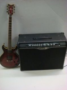 Schecter Diamond Series Guitar in Hard Case with Amp: Great for Beginners. Solid Body Electric Guitar, 1 Volumn and 2 Tone Knobs, Toggle Switch. Abalone Inlay Rosewood Fretwork. Red Marbled Finish, Leather Strap and Cable. Humbucking Pickups. (100-250)