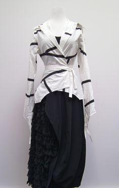 Anda geometric blouse over an Ivan Grundahl camisole and  Ivan Grundahl tulip shaped skirt with side ruffle detail.