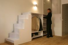 Real (Cool) Madrid Micro Loft - the stairs are on casters and roll out to reveal storage and a closet.