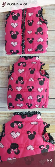 ^ ^ Disney Infant Toddler Minnie Mouse Puffer Vest Disney Infant Girl Toddler Minnie Mouse Puffer Vest.   Pink with Black Minnie Mouse Heads and Pink Hearts.   Ruffles Around Sleeves and Neck Edge.   Full Zip Front.  Size S (12 Months).  Gently used condition with no flaws. Please see photos for details.  Armpit to armpit:  19 inches, laying flat, unstretched. Length:  24 inches. Disney Jackets & Coats Vests