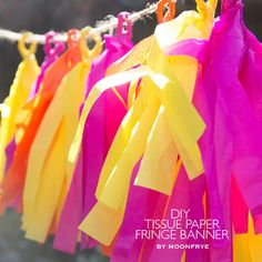 DIY Tissue Paper Fringe Banner by Moonfrye.com  DIY tutorial on how to make this festive tissue paper banner! #moonfryeDIY #partydecor
