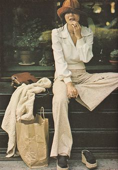 Just Seventeen- September 1973. 'Vivian Wang believes in dressing for comfort and in looking good with little fuss.' 70s pants blouse sweater purse platform sandal shoes hat white tan casual day wear photo print ad vintage fashion