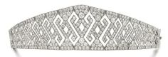 DIAMOND DIADEM, early 1900s. Openwork geometric design. Diadem can be detached from the frame and and worn as a bracelet (bracelet length 163mm).  From the Collection of the Family of Baron Hottinger. Fitted case stamped A. Aucoc. | Sotheby's. (=)