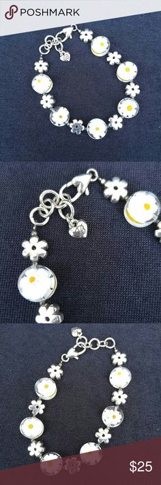 Beautiful Brighton bracelet Brighton bracelet has six white daisies (two sided) on a silver chain. New worn because I have large wrists. Bracelet is 8 inches long. Adjustable. Brighton Jewelry Bracelets