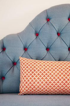 tufted headboard with colored buttons