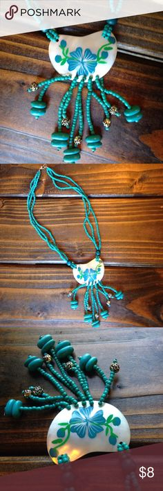 Boho shell necklace Hand painted shell with turquoise colored beads. Little silver toned flower beads. Jewelry Necklaces