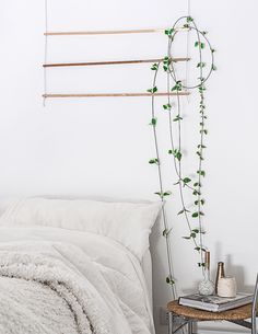 Do you have a plan to bring your garden indoors this winter? Blogger Agata Dimmich of Passion Shake made a DIY Wall Hanging to add greenery to a bedroom wa