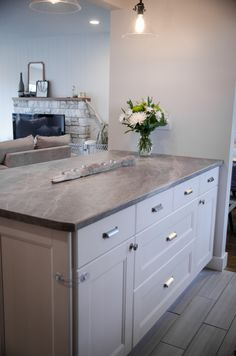 "Follow Colleen's Kitchen Renovation over at Lemon Thistle. She chose Formica 180fx Laminate Soapstone Sequoia for her new counter tops.   ""We chose Formica laminate counter tops (180fx Soapstone Sequoia) to keep within our budget and love how it turned out. I really like the flat finish and although I wish stone was in our budget, this doesn't look cheap, and it works perfectly."""