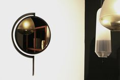 Contorno mirror By Studio Jolanda van Goor 2016. Powder coated black steel and bronze mirror