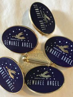Whether you wear your Sewanee Angel on your gown, lapel, back pack, or bag,  she will remind you that you are always protected and a piece of Sewanee is  with you.  Purple enamel background; gold angel; white lettering and whimsical Gay  Alvarez stars  Perfect Gowning gift!  No Gown should