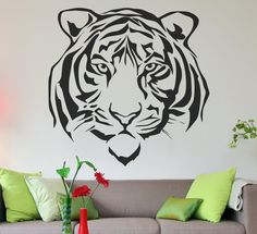 This LARGE Tiger face vinyl wall decal will be sure to make a statement in your home.  Our wall decals also come in a variety of colors to fit your homes decor.  Gets yours today to easily have the most talked about piece of art around.  Find them here: https://www.etsy.com/listing/387516412/tiger-face-oversized-wall-decal-vinyl