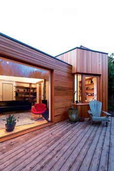 A Cedar-Clad Extension | Homebuilding & Renovating. Combination of vertical and horizontal cladding makes it look more sculptural I think.