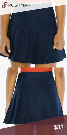 "AMERICAN APPAREL TENNIS SKIRT An American Apparel Icon, this sylish yet understated pleated Tennis Skirt is constructed from a soft and flowy gabardine fabric.  Garbadine (100% Polyester) construction  Zipper and button closure  Small is approximately 15 1/4"" (38.7 cm) in total length   Imported American Apparel Skirts Mini"