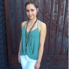 Brand new halter high low green top This super chic green top comes in a size medium only but the halter neck strap can adjust so it can be made smaller. It's super cute and looks great under a cardigan, blazer or even by itself Naked Zebra Tops Blouses
