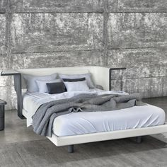The KOSY Bed is available in an upholstered headboard and wooden headboard version. http://www.yliving.com/blog/huppe-bedroom-furniture/