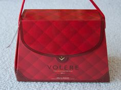 LOL  Volere Wine Purse (spout on the side). Ladies, you know you wanna add this to your Christmas Wish List!
