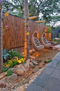 Love the hanging chairs. Hang from fashioned hanger on fence.