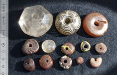 spindle whorls and beads from Rhenen grave 413: rock crystal, glass, amber, mid to early 2nd half of 6th c., Leiden Rh 413