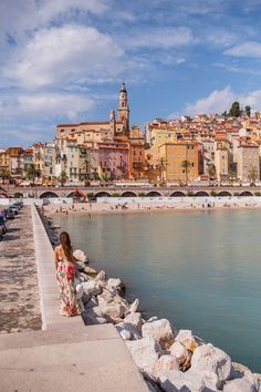 The coastline of Menton, France, seen from the Quai Impératrice Eugénie. Menton is a lesser known little town on the French Riviera, just before you cross into Italy, that beats its glamorous neighbours in charm and ambiance. It has a beautiful bay with houses in an array of warm tints spilling down the hillside to the sea.