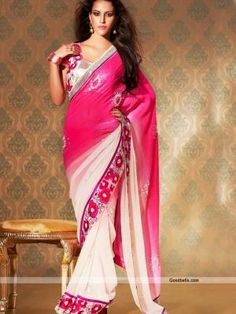 Grab all the attention wearing this shaded pink and white saree. Silver stones and moti work looks attractive on pink. Heavy border makes it partywear attire. http://goodbells.com/saree/pretty-white-and-pink-shade-saree.html