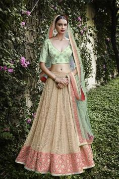 ETHNIC GRANDEUR 5055 Exhibiting The Captivating Embellishment Of Zari And Thread In Subtle Hues Of Pink And Green. Skirt In Self Embroidered Beige Lehenga Along With Pallu In Sea Green Net Blouse In Sea Green Bhagalpuri Fabric With Seuin Butas All Over Buy Now:- http://eshop.nakkashi.in/ethnic-grandeur-5055.html