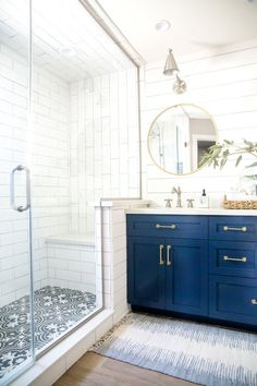 Budget friendly white subway tile and bold patterned floor