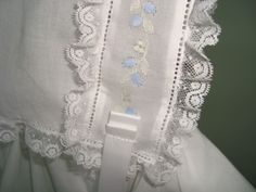 classic baby bonnet, embroidered insertion with entredeux and french lace on lawn.