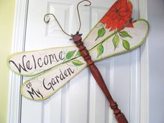 "Table Leg Dragonfly Wall or Garden Art sign- ""Welcome to my Garden"" with flower and leaves. $65.00, via Etsy."