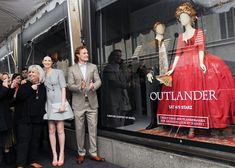 Outlander's Caitriona Balfe and Sam Heughan Stun at the Unveiling of the Show's New Saks Fifth Avenue Window Display from InStyle.com
