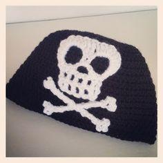 Last week, my oldest son requested I crochet him a pirate beanie. A pirate beanie? I wasn't sure my skills were quite u. Crochet Skull, Crochet Socks, Crochet Beanie, Knit Or Crochet, Crochet For Kids, Half Double Crochet, Single Crochet, Halloween Crochet Patterns, Pirate Hats