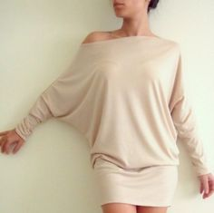 Dolman sleeve sweater dress.I would pair with black tights and riding boots