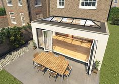 Flat roof extension with skylight & bifolding doors Orangery Roof, Conservatory Roof, Modern Conservatory, Garden Room Extensions, House Extensions, Kitchen Extensions, Orangerie Extension, House Extension Design, Extension Ideas