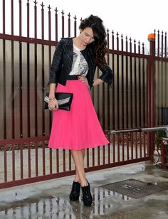 Leather jacket + colourful mid skirt.