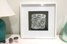 Beautifully sculptured curved vine in silver tones pigments.
