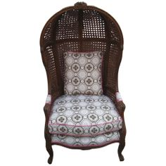 Rattan-o-Rama! A Vintage Rattan Hood or Canopy Chair with Tony Duquette Upholstery. In our 1st Dibs boutique.
