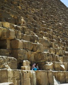 Egypt. Giza Pyramids. People on Great Pyramid showing the scale of the blocks