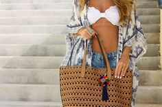 Swimsuit: Top and Bottoms // Kimono: Nordstrom, similar here and here // Shorts: One Teaspoon // Bag: Nordstrom // Pom Keychain: ASOS, love this and this// Sunnies: Quay // Happy Friday!Anybody el