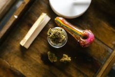 Red and Gold Smoking Pipe on Brown Wooden Table · Free Stock Photo Cannabis Shop, Buy Cannabis Online, Irritable Bowel Syndrome, Crohns, Spices, Outlets, Countries, United States