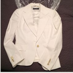 Dolce & Gabbana Beautiful White Blazer - SALE Flash sale! ✨Today's biggest fashion is all white everything. Sophistication at it's finest. Dolce & Gabbana. Made in Italy. Beautiful white cotton blend blazer with satin-like rayon blend lining. Single button closure with four button detail sleeve cuffs. Buttons have D&G logo. It's a beautiful a staple piece for any wardrobe. Freshly dry cleaned. Dolce & Gabbana Jackets & Coats Blazers