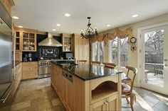 Oak kitchen with stainless steel appliances.