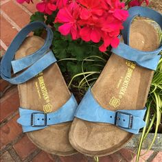 NWOT Isis Birks in beautiful cornflower blue- 38 These are the very popular and rare Isis style of Birkenstocks in a light sky blue. They are new but without a box. Great condition- have not been worn, have no footprints or scuffing of the bottom sole of the shoe. Pictures show most all sides of shoe- but if you need more info feel free to ask!!  Birkenstock Shoes Sandals