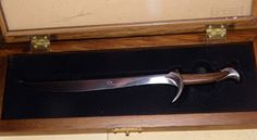 Looking for a Hobbit replica sword that you can actually afford? This is an Orcrist letter opener, and it's awesome.